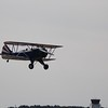Biplane taking fly by runway.