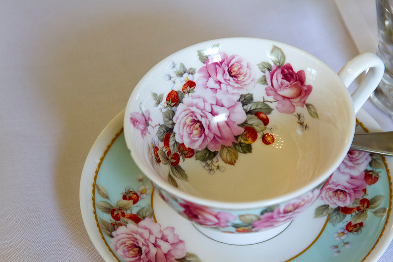 tea cup and saucer with roses on it