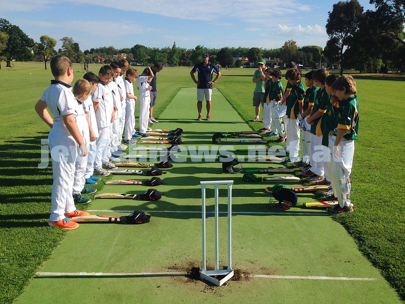 30-11-14. Maccabi AJAX U11 Blue (left) and Glen Iris observing 63 seconds' silence before Sunday's game in memory of Australian cricketer Phil Hughs. Photo: Benji Jotkowitz