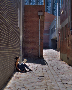 Girl reading in the street