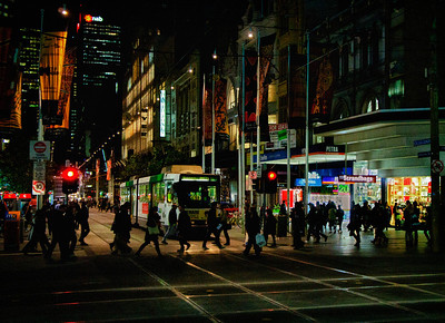 Pedestrians out at night, Corner Bourke & Swanston. June 2011.