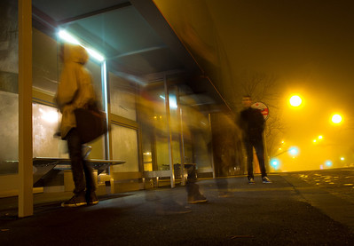 Commuters in the fog. Melbourne University bus stop, 29 June 2011