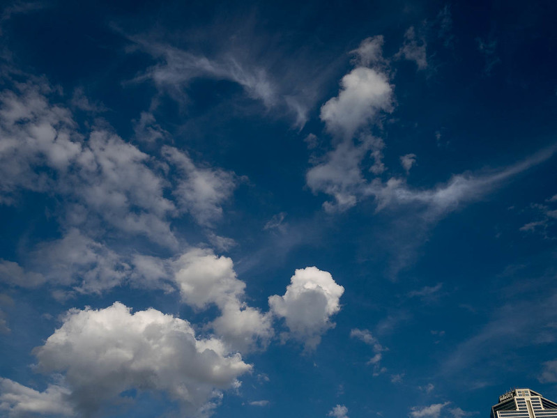 Clouds on blue sky, looking very 3-D.