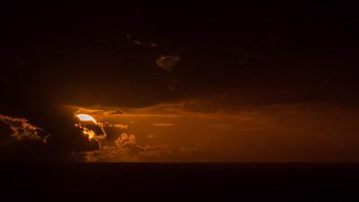 Dark storm clouds embracing the sun