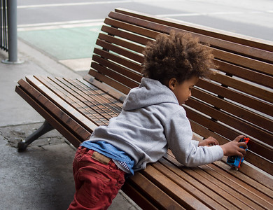 Child playing on a street bench, Jan 2014.