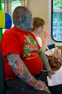 A guy with beautiful Christmas tattoo.