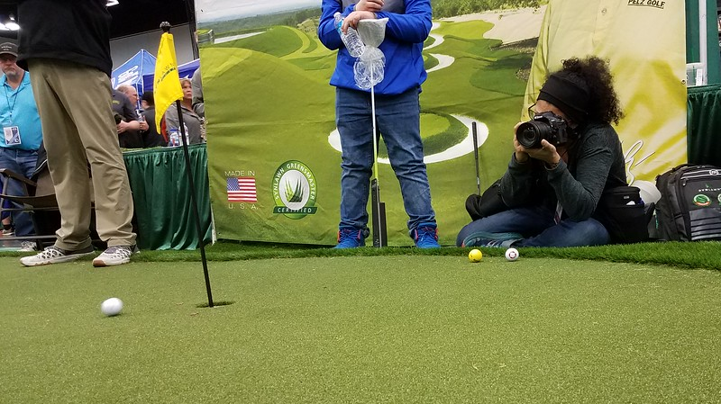 (Feb 23, 2019) Melissa Toledo in action shooting Event Photography for the Portland Golf Show at the Oregon Convention Center.  Image captured by Brian Votaw.