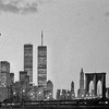 Viewed from the approach to Brooklyn Bridge, the old Twin Towers of the World Trade Centre dominated the New York skyline in the 1980s. Scanned from the original negative, shot at dusk in winter, this is a naturally grainy image.