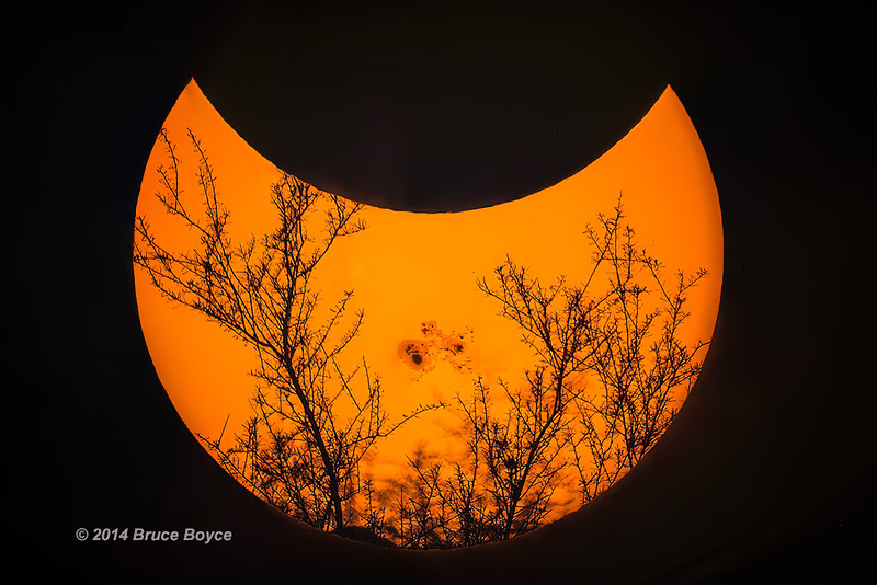 102314-Partial Solar eclipse by the moon as sun sets