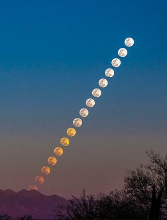 030118-Full moon rises behind the Four Peaks