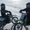 """Here is a cool picture of my 7-year old son, Zachary Berndt, and his 8-year-old friend, Ryan Kemnetz, ice riding on Lake Winnebago, Wis., on Dec. 28, 2009.  Take note the ice tires were built from Dunlop MX51 series tires. Zachary is on the white KLX110, Ryan is on the green KLX110."""" - Scott Berndt of Appleton, Wis."""