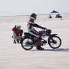 """""""Me on my 1966 Honda 90 at the starting line at the recent BUB-AMA speed trials on the Bonneville Salt Flats.  I now hold the AMA record for the 100cc P-PP class at 53 mph.""""  - Roy Williams  of Minneapolis, Minn."""