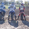 """""""We are at the track every weekend riding. Left to right: Myself 361, AMA member and still racing motocross at 56, my oldest son Mike 952, AMA member and motocross racer, my youngest son Gregg 361 who just likes to ride and beat his dad and the spoiled grandson Oliver on his PW50 3 years old. Photo at the track we belong to Aztalan Motorcycle Club in Aztalan, Wis."""" - Tony Leccesi"""