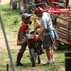 Wolfgang Neuwirth and his son, Hunter, after Hunter finished second at the Aztalan Cycle Club Hare scrambles this summer. - Dave Hollub of Sauk City, Wis.