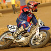"""""""This is Jake Mccullough from Ottawa, Ill. He is racing at the amateur short track at Springfield, Ill., on Labor Day weekend 2009. Jake can ride because Mert Lawwill made him a special hand. Jake is missing his right hand and part of his right arm this happen at birth."""" - Jack Mccullough"""