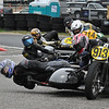 """""""USCRA Vintage sidecar race at New Hampshire Motor Speedway in Loudon N.H., on Sunday, June 13. Racers are rounding turn 3. If you look at the photo at full size, you'll notice the 3rd-place rider is smiling!""""  - Bob LoCicero of Huntington Vt."""