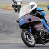 """This shows me on my 1991 BMW R100RT at a Fishtail Riding School track day at Loudon, N.H.  See, even old touring bikes can learn to go fast!"" - John Helming of Ledyard, Conn."