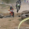 """""""This picture is of Corry Davis in a hare scrambles at Trollhaugen, Minn. He's jumping an obstacle of tires. He's in the running for first place. He's the one in the air."""" - Mary Davis of Ramsey Minn."""