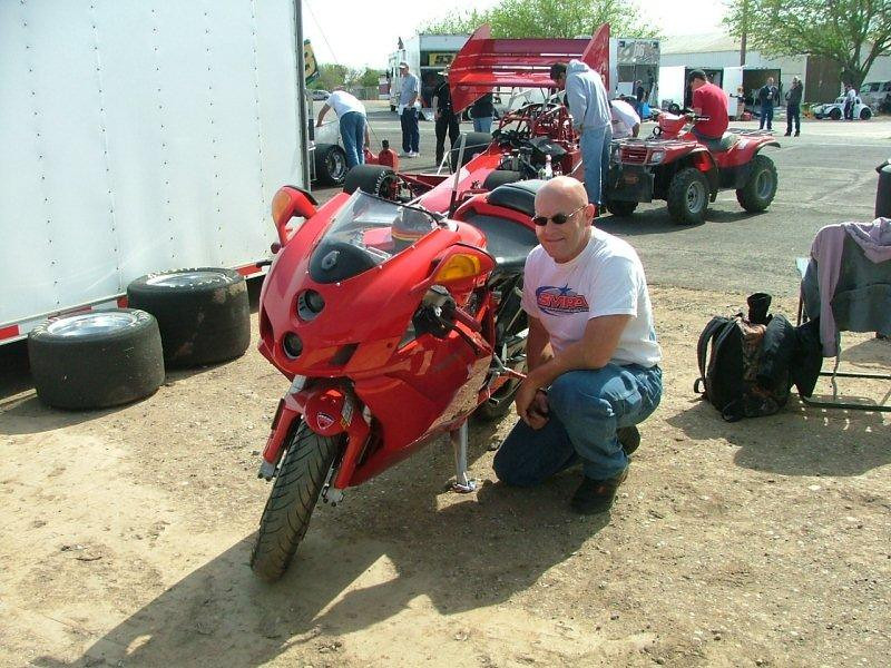 """""""AMA Member and occasional Super Modified Racing Association  crew member, 'Left Coast Tim' Marsh, pictured here at Madera Speedway in California. He's a fan of all fast machines, two- or four-wheel, oval-track or road course. As far as he knows, his 749 was the very first Ducati ever in the track's pits."""" - Tim Marsh of Barstow, Calif."""