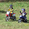 """""""My son, Nathan (Honda CRF70), and his best friend, George (Yamaha PW50), discuss their lines after a few warm-up laps."""" - Tim Bruce of Gainesville, Va."""