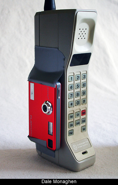 """Mounting the Flatfoto camera (46 grams) to the Motorola """"Brick"""" cell phone (24oz or 1.5 lb) does not decrease the portability of the phone."""