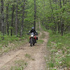 """A photo is of my son, Ted Tackett, on his 2008 Triumph<br /> Scrambler. He rode the Scrambler on the AMA Dual Sport ride at Whiskey<br /> Creek, Mich. The event was sponsored by the Great Lakes Dual Sporters, of<br /> which Ted and I are members. Seeing the big ""old"" Triumph cruising down the<br /> two-tracks of Northern Michigan brought back many memories of the good old<br /> days for the, um, more senior members. Younger members just shook their<br /> heads when told about the old days when Triumphs, BSAs and the like were<br /> common off-road rides. They had no desire to trade there DRZ's in for an old<br /> TR-6."" - Charlie Tackett of Kalamazoo, Mich."