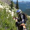 "Susan Post (""Flying Ant"") stopping to smell the bear grass flowers in Gifford Pinchot National Forest, Wash. - Russell Burress of Portland, Ore."