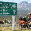 """""""My son, Ethan Rogers, age 8, ready to go on our '08 KTM 990 Adventure in Haines Junction, Yukon, Canada.  Summer '09 – we'd ridden up all the way from Lake Arrowhead, Calif.  What a ride!  My son loved every minute of our journey, never complained, never asked to stop, even on our longest mile-munching days.  The ride we were about to take when this picture was snapped is the most beautiful stretch of road on earth – through the lower Yukon, a tiny taste of British Columbia, then into Haines with more glaciers and magnificent bald eagles than we could count."""" - Eric Rogers of Lake Arrowhead, Calif."""