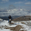 """Photo was taken by Gary Schmidt at the top of Mosquito Pass (in Colorado) on Sept. 13, 2009. This was a dual-sport ride that included Michigan, South Dakota, Nebraska and Colorado dual sporters. That's Leadville, Colo., in the background and Jim Noteboom on the XC BMW. Second tracks in the morning snow."" - Jim Noteboom of Evergreen, Colo."