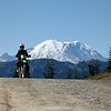 """""""This is my friend Roger Whitlock with Mt. Rainier towering over him during a ride in the Little Naches area of Washington state."""" - Bill Mallory"""