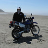 """""""We just returned from a short camping trip to the beaches here in the state of Washington. The beaches are known more for clam digging than motorcycle riding, but I had to send along a picture of me with my 2006 Suzuki DR 650, just to show that it's not a bad way to spend an afternoon. The beaches here are open to motorcycles as long as they're street legal. I know they'll never make it on any list of the top 15 best roads, but after spending my first 35 years of motorcycling in Colorado, this was definitely something different and fun."""" - Dave Knoetgen"""