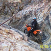 """""""AMA District 37 (Southern California) Dualsport Committee Vice President Gil Busick Traverses a waterfall in the El Paso Mountains outside of Ridgecrest. Calif. - Photo by Dan Frisch."""