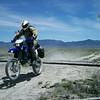 """Honda Bob on a Suzuki crossing the Nevada Northern Railway in Goshute Valley in Northeast Nevada."" - Christopher Alvord of West Wendover, Nev."