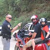 """""""A pic of my boy, Chris, and I in June, 1998, stopped at a random check point on a lonely dirt road in the Nantahala mountains of North Carolina.  Even the cops are nice in North Carolina!  He couldn't help but smile."""" - Gary Thiemann of Monroe, N.C."""