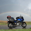 """Mid-afternoon on June 22, I headed south out of Alliance, Neb., on Highway 385 hoping to beat a storm. I didn't and it was a doozy -- wind, rain, sleet, lightning. I finally rode out of it just north of Bridgeport and was rewarded with this rainbow. If you look close you can see the second rainbow above.  I was on my way to the 2010 North American V-Strom gathering in Montrose, Colo."""" - Carter Kerk of Rapid City, S.D."""