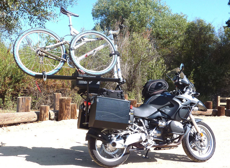 """""""I am submitting these photos of my 2005 BMW GS 1200 that I made a bike rack for. I mount my mountain bike on my GS so I can go mountain bike riding during peak traffic times in the LA area. 'Ride to ride.' And when I'm done, the rack comes off quickly as I've mounted it with quick release pins. This rig gets lots of looks as I lane split in the Los Angeles traffic. It rides very stable,( the bike only weights 24 pounds), and does not extend any wider the the motorcycle. There's no limits to what's cool about motorcycling, keeping it safe is always No. 1."""" - Allen Robinson of Agoura Hills, Calif."""