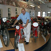 """Peter Calles of Bethesda, Md., at the old MV Agusta museum in Italy. """"I took a ferry ship from Greece over to Italy to go see the Ducati and MV Agusta factories,"""" he said."""