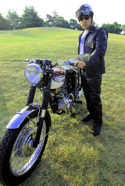 """""""As staff photographer for Meadow Brook Concours d'Elegance in Rochester Michigan, this shot is of an owner dressing the part posing with his Triumph."""" - Steven Hauptman of Southfield, Mich."""