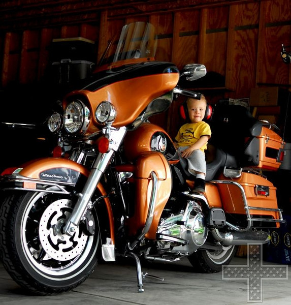 """""""My grandson, Oz, who climbs on my bike every chance he gets."""" - Mike Betschart of Steger, Ill."""
