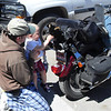 """""""A 2 year old admires Blacky Bear who rides with Gene Schlaick wherever his<br /> Sportster goes."""" - Gene Schlaick"""