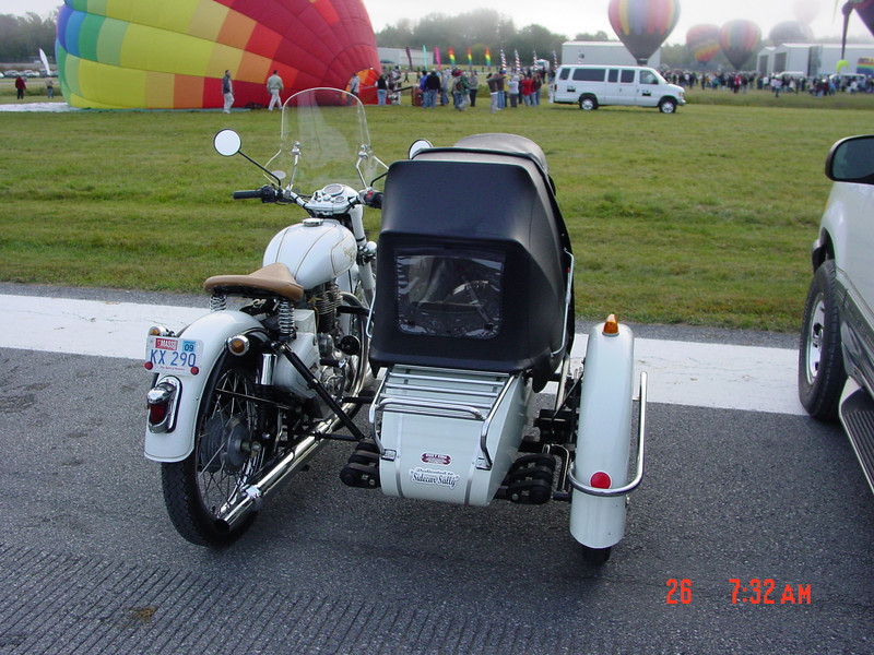 """""""Taken in Warren County, N.Y., close to the home of our wonderful Americade Rally. I've attended this hot air festival on several occasions.While walking around I came upon this motorcycle and as I looked it over I noticed this glorious view of two great ways to enjoy the freedom of fresh air and visual wonderment."""" - Harry Drahushuk of Kinderhook, N.Y."""
