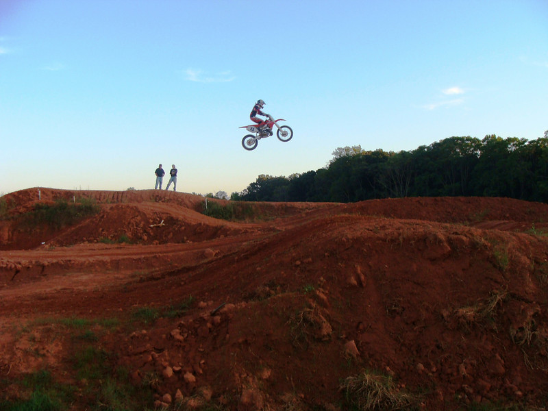 """""""This is a picture of my brother (the rider) jumping a huge double, with my dad and my brother's coach critiquing him on the far side of the track. My brother is 14 and races a CR250R. The picture captures whats cool about motorcycling because it shows my brother pushing his limits and jumping as high as the trees. Motorcycling is one thing that brings my dad and brother together. Dad enjoys mechanicing and going to practice and racing just as much as my brother does."""" - Kelly Owens of Westminster, S.C."""