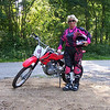 """In the summer of 2006, my husband of 26 years died rather suddenly at home. After three years of recovering from the loss, I  realized my life-long dream and bought myself a dirtbike!  I have a new life now, at the age of 59+1/2 pursuing my dirt- bike dream!  Although, a newbie, I am enjoying life on my Honda CRF 100. We will be cutting trails on our own land in the woods of New England!  This is a message of ""Hope"" to all those dreamers out there........it's never to late to learn and obtain your dream!"" - Gayle O'Donnell of R.I."