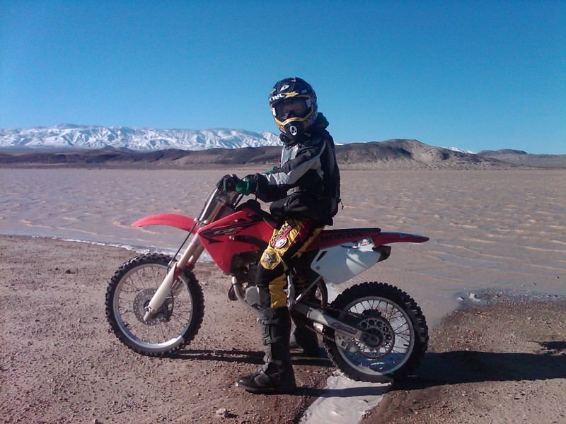 """Nico Schneider at Johnson Valley, Soggy Dry Lake, California.AMA District 37 (Southern California) Desert MC 43rd Winter Classic Jan. 24, 2010. He is in SoCal MC.Big Bear covered in snow in the background."" - Roy Schneider"