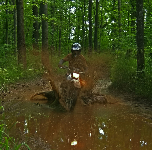 Brian Elling riding in the iron-rich mud in the Chengwatana OHV Park, Pine City, Minn.