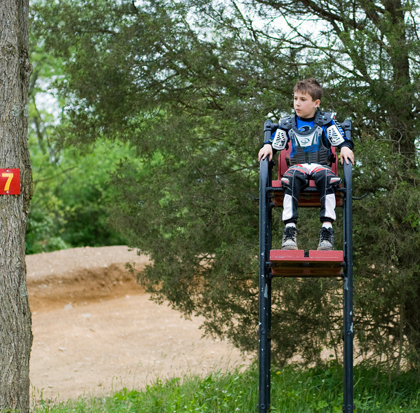 """""""In the summer of 2009, my then 8-year-old son, AMA member Jaedan Morton, took a break from riding his Yamaha PW50 at a private track to watch Dad jump a double. The spotter's chair provided a great view."""" - Dan Morton of Mechanicsburg, Pa."""