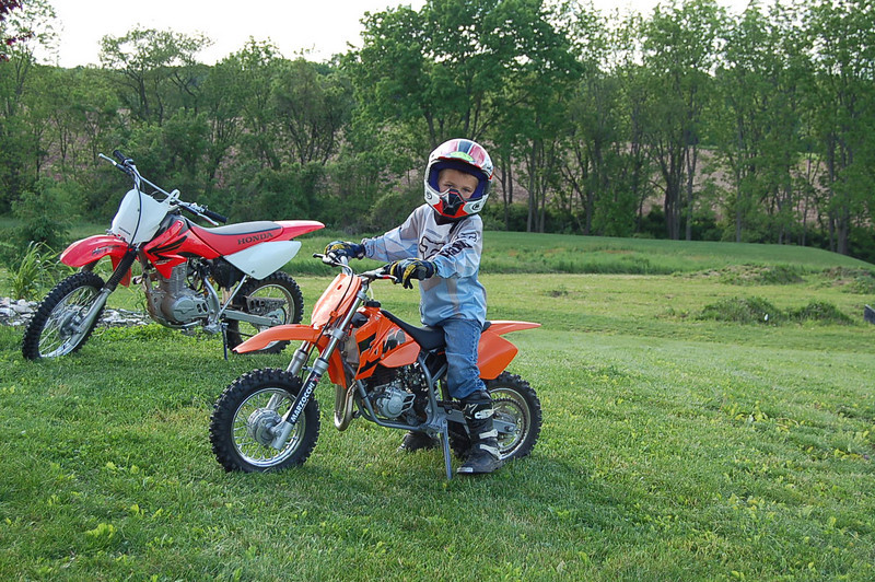 """""""Kids just got done riding there bikes around the backyard on a warm summer night. My son and I both race hare scrambles."""" - Gerald Peklak"""