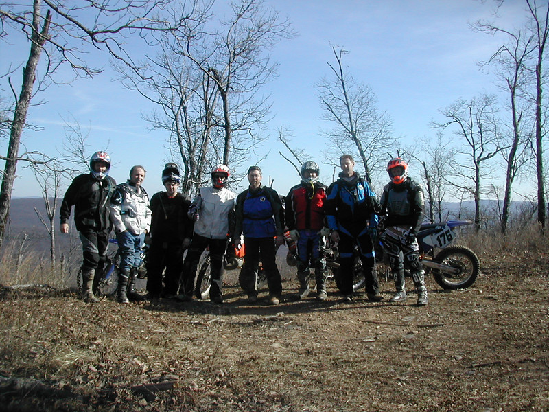 """The first week of December a group of eight riders from the Iowa City Competition Riders Motorcycle Club took a trip to the Mill Creek OHV riding area of the Ozark National Forest in northwest Arkansas. (L-R) Brad Melick, John Wertzbaugher , Kyle, Tim Ellsworth, Jim Simpson, Tim Bross, Jim Neff, and Bill Madden. It was a great ride! Special thanks to our two guides not pictured from Arkansas: Scott and Perry."" - Bill Madden"