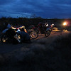"""This photo was taken on Feb. 18, 2011 on The Mojave Road about 30 miles outside of Laughlin, Nev. With over 200 miles of dirt riding under our belt that day it was getting dark and a was storm approaching. The fuel filter on the XR400 broke off due to a lost tank-mount bolt. We had to fix it and get moving or we were going to get very wet and cold. We fixed it. (I like this photo because it tells the whole story.)"" - Jeff Sewell"