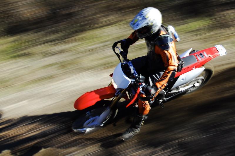"""""""Vic Schiavone flies through a fast section of trail on a friend's property on eastern Long Island, N.Y., aboard an '07 CRF250X."""" - Tommy Stanwood."""